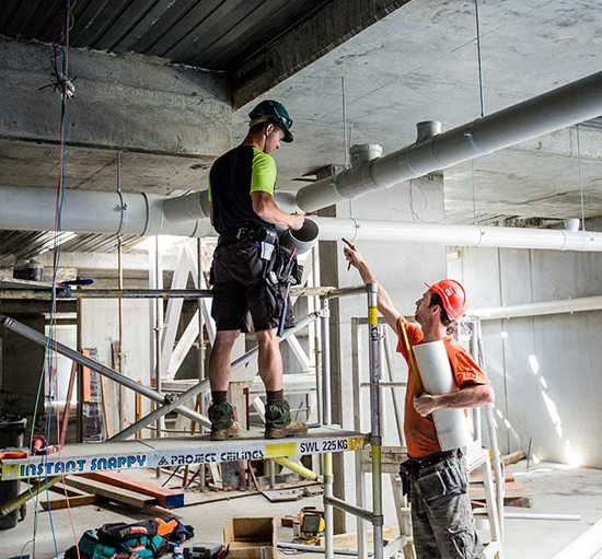 Plumbers fixing water pipes | Commercial Plumbers Near Me