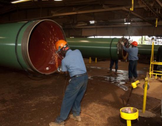 Men repairing pipe lines
