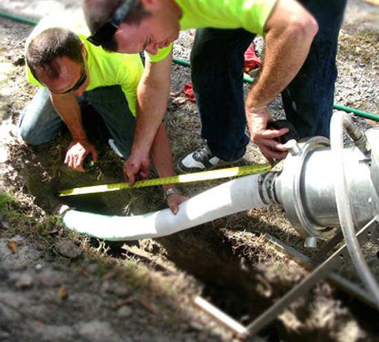 Men replacing a trenchless sewer line